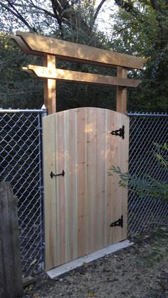 Saturday project: Simple cedar pergola and gate to dress up a plain chain-link fence. http://ift.tt/2gr0Y98