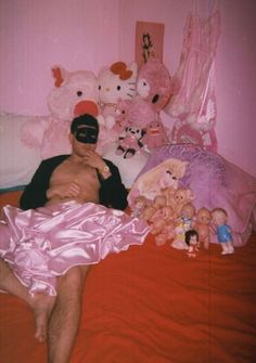 Man on bed with dolls Epic Sexy Fails Bad Glamor Shots Dating Sites Profile Pics Awkward Family Photos