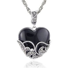 $309.99 Add instant drama with this ornate pendant, featuring a black onyx heart, cradled in a fancy scroll setting of textured sterling silver and glittering marcasite. A coordinating decorative bail joins the pendant to a sterling silver chain.