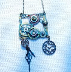 Large Steampunk Vintage Real Brass clock plate pendant with gear charm details . Tarnished patina, clock gears, clock hands, faux gems,watch part detailing, On 20 inch brass chain with clasp. Hand painted, handmade. One of a kind. Perfect for Cosplay.  Pendant measures 2 & 1/4 inch wide by 2 inches tall with clock charms hanging at bottom.  TOP GEAR STILL SPINS. - ( When turned by hand )