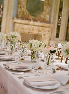 light pink table linens and white and peach bouquets http://www.itgirlweddings.com/blog/blushing-malibu-bridal-shower