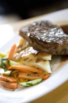 New York Strip Steak with Potato Galette and Seasonal Vegetables by D'Amico Catering, via Flickr