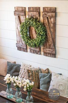 A DIY home decor project that is perfect for a beginner woodworker. These rustic style decorative shutters only require a few simple materials and come together quickly.  Come check out this project on the blog!  #rusticdecor #diyproject #woodworking #farmhousedecor #diningroomdecor