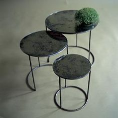 black, round nesting tables