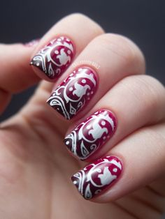 Bandana Gradient ... OPI Manicurist of Seville base, sponge on L'Oreal Haute Couture. Stamp on design using Konad Special Polish White and the Shany plate SH20