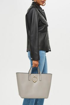 9afd236918419 Carry your essentials in style with our chic leather look tote bag in grey  with hardware. Topshop