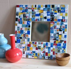 Expired credit cards, used gift cards, and outdated insurance cards aren't of much use to anyone! Unless you cut them up and make them into a colorful, sparkly mosaic. Here's a tutorial for covering a frame with your old cards.