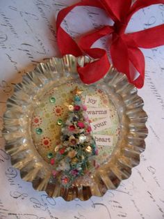 tin ornament with small christmas tree