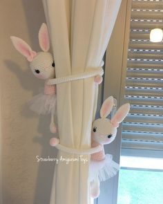 This is an amigurumi bunny curtain tie back. Its about 30 cm tall. It is crocheted with acrylic yarn and filled with fibre. Its arms are about 24 cm. You tie it around the curtain. It is a good object for girls nursery. This price is ONLY for one bunny. I can prepare your order in any