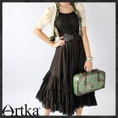 Cute black dress with shrug - agreed, but i don't like the belt