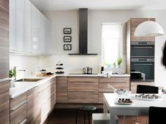 We Love: Contrast in the Kitchen Ikea Kitchen, modern brown and white. I would do the Adel white on top, the shaker style.Ikea Kitchen, modern brown and white. I would do the Adel white on top, the shaker style. Kitchen Interior, New Kitchen, Kitchen Dining, Kitchen Decor, Walnut Kitchen, Gloss Kitchen, Kitchen Wood, Apartment Kitchen, Dining Room