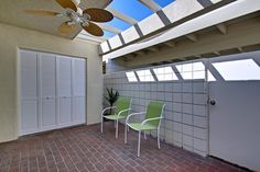 ...fully equipped kitchen overlooking a walled-in private patio...