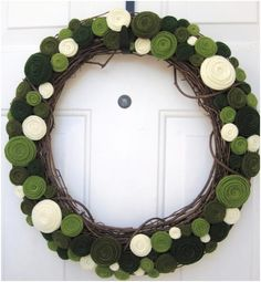 Felt Flowers on natural wreath by handmadecollectibles on etsy