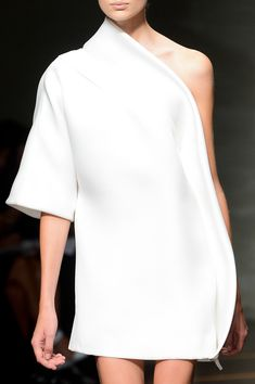 The beautiful simplicity of this one shoulder dress makes such a speak volumes.  Gianfranco Ferre SPRING 2013