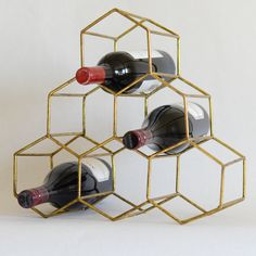 Love wine and short on space? This space saving pyramid wine rack will fit perfectly on your counter top, bar, or sid Rose Gold Rooms, Honeycomb Shape, Pantry Organisation, Shelving Design, Fancy Houses, Wine Bottle Holders, Dining Room Bar, Copper And Brass, Home Decor Inspiration