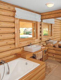 Современный «минималистичный» дом из оцилиндрованного бревна