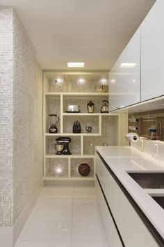 Kitchen - Shelving for storage of appliances & objects of art....adds a great dimension to the kitchen space.