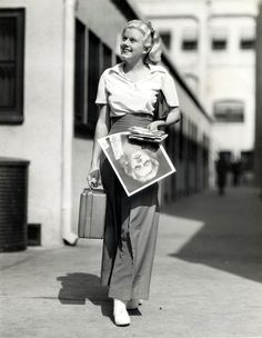 Jean Harlow carrying some head shots on the MGM lot Aside: About a year ago on eBay I found an autographed photo of Harlow made out to Brownie, which was a nickname of Garbo's. Anyway, it was amazing,...