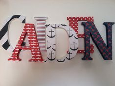 "K and M 12"" letters in the white with navy anchor design on each side of the window"