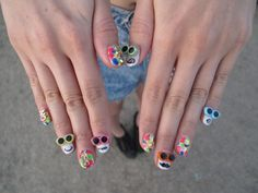 Nail art is almost as important as outfits this year at Coachella. WGSN street shot