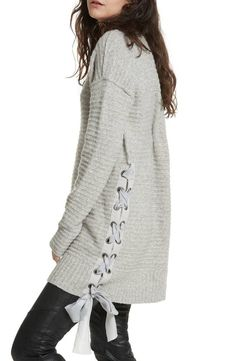 Lustrous chenille yarns bring an extra measure of coziness to this amply sized sweater finished with pretty satin ribbon laced up one side.