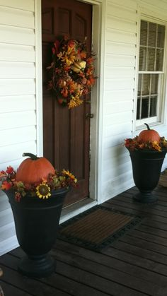 Front Porch Decorations for Autumn - love the pumpkins in the planters.