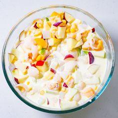 Filipino Fruit Salad Pour milk and cream mixture into bowl