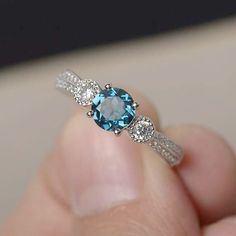 This White Gold Floral Wedding Ring Bridal Set Blue Topaz Engagement Ring Diamond Wedding Band is just one of the custom, handmade pieces you'll find in our bridal sets shops. Rose Gold Engagement, Antique Engagement Rings, Unique Rings, Beautiful Rings, Diamond Wedding Bands, Wedding Rings, Topas, Ring Verlobung, Blue Topaz Ring