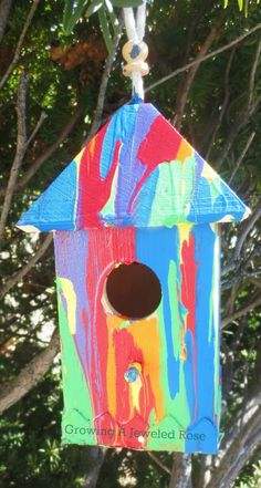 Here is a fun craft for Spring- RAINBOW pour paint birdhouses!  Beautiful and the painting technique is oh so fun for kids!