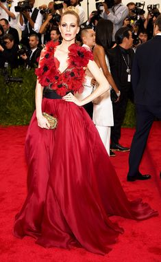 Poppy Delevingne in a stunning low-cut Marchesa silk poppy flower gown at the 2015 Met Gala