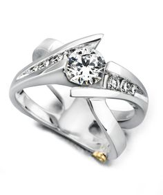 The Elegance engagement ring contains 7 diamonds, totaling 0.285 ctw. Center stone sold separately, not included in price.