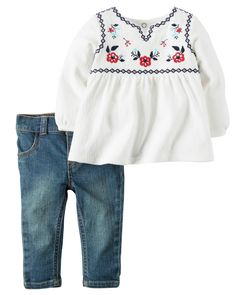 Complete with an embroidered babydoll tunic and stretchy denim, this 2-piece set is perfect for picture day.