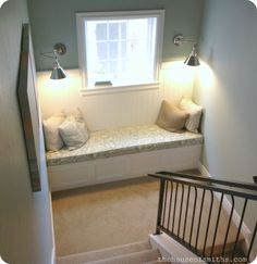 reading nook in stair landing - Love this, likely wouldn't work well in our house though.
