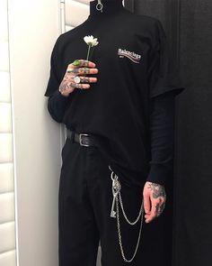 Half-zip short sleeve turtleneck over black longsleeve, black trousers w/ chain
