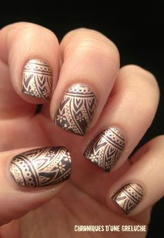 I'm not sure how this is done but it is gorgeous and one of the classier versions of all the nail art insanity that's happening right now.