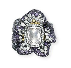 A DIAMOND AND AMETHYST 'THREE-VIOLETS' RING, BY JAR Designed as three violet flowerheads pavé-set with amethysts, diamonds and yellow diamonds, the central flower centering upon an old-cut cushion-shaped diamond, weighing approximately 2.50 carats, mounted in silver and gold, 2002, ring size 4¼ Signed JAR Paris