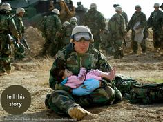 Navy Hospital Corpsman Richard Barnett holds a child after she was separated from her family during a firefight. [Iraq War, - 42 Powerful Moments Of Human Compassion In The Face Of Violence La Compassion, Us Army Soldier, My Champion, Iraq War, Afghanistan War, Support Our Troops, Les Sentiments, We Are The World, American Soldiers