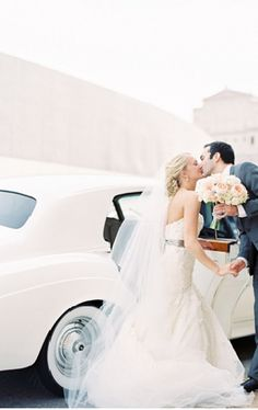 Love everything about this picture! Perfect dress, bouquet and getaway car!