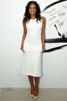Gabrielle Union: A minimalistic appeal at its best. This uber flattering A-line midi frock, dresses Gabrielle's curves effortlessly.