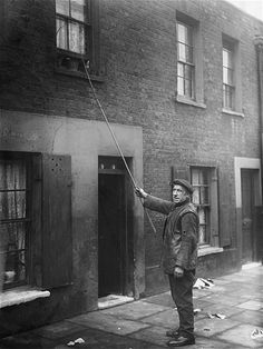 Jobs That No Longer Exist Today. Knocker-uppers were essentially alarm clocks – they were hired to ensure that people would wake up on time for their own jobs. They would use sticks, clubs or pebbles to knock on clients' windows and doors. Old London, East London, Back In Time, Back In The Day, Old Photos, Vintage Photos, Vintage Photographs, London Neighborhoods, Morning Call