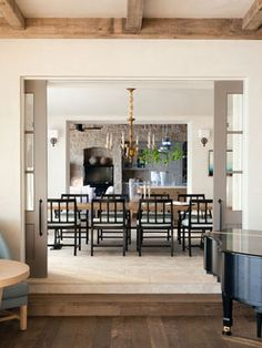 French doors for dining room dining room mediterranean with sunken living room exposed beams exposed stone Small Space Interior Design, Interior Design Living Room, Interior Decorating, Glass Pocket Doors, Sunken Living Room, Sweet Home, Build Your House, Mediterranean Style Homes, Stone Kitchen