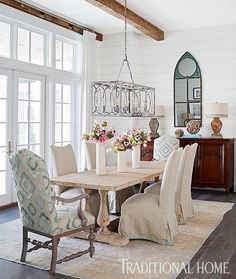 Florida Family Vacation Home, When it comes to the dining room, the soft blue tones of the Oushak rug inspired the decor, including host chairs covered in a Lee Jofa fabric.