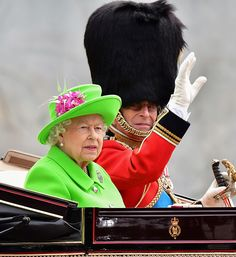 Britain's Queen Elizabeth II and Britain's Prince Philip, Duke of Edinburgh travel in a horse-drawn carriage past Buckingham Palace on the...