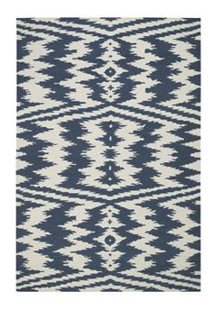 Best of friend AM bought this blue and off white flat weave rug from the Genevieve  Gorder for Capel Rugs collection for her NYC apartment!  I want one (both the apartment and the rug!). http://cococozy.com