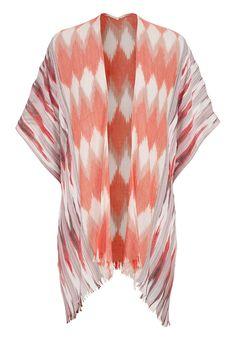 patterned ruana wrap with frayed hem