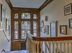 Many original stain-glass windows and doors remain in the home. There is a nine window Tiffany grape arbor window on the main stairway landing.