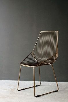 This is a super stylish dining chair which is a unique change to traditional chairs The Midas Chair is created in a antiqued gold metal and features