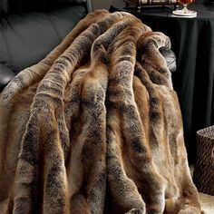 Handcrafted faux coyote fur throw with a velvet lining. Product: ThrowConstruction Material: Mod-acrylic faux fur