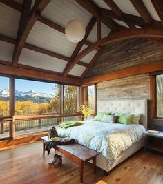 Stunning rustic cabin bedroom with the best view of the mountains! YES please!