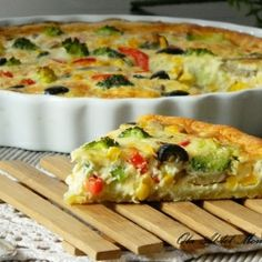 Vegetarian Quiche with Broccoli, Black Olives, Yellow and Red Peppers, and Mushrooms   |    Olaahmed